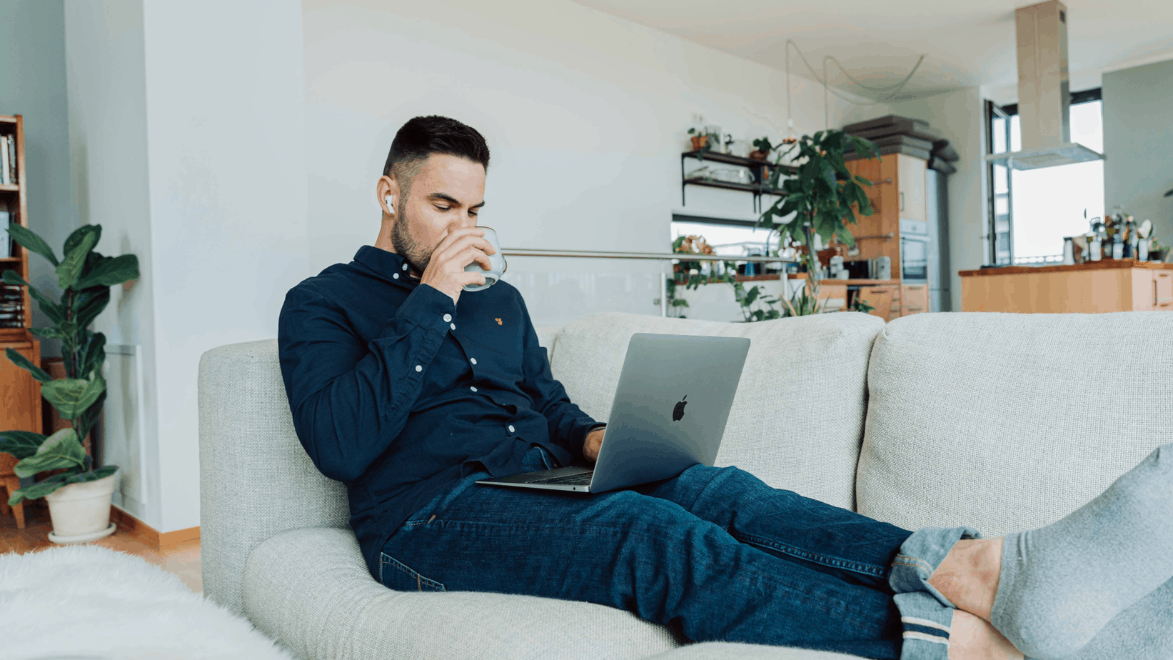 man with laptop on couch | work-first culture